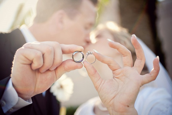 bride-groom-holding-wedding-ring-kissing