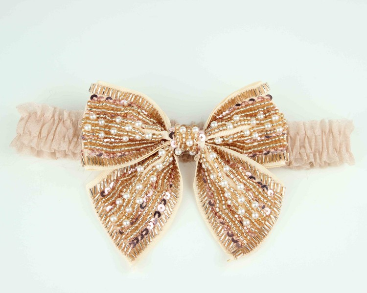 gold-beaded-bridal-garter-bows-2012-wedding-trend.original