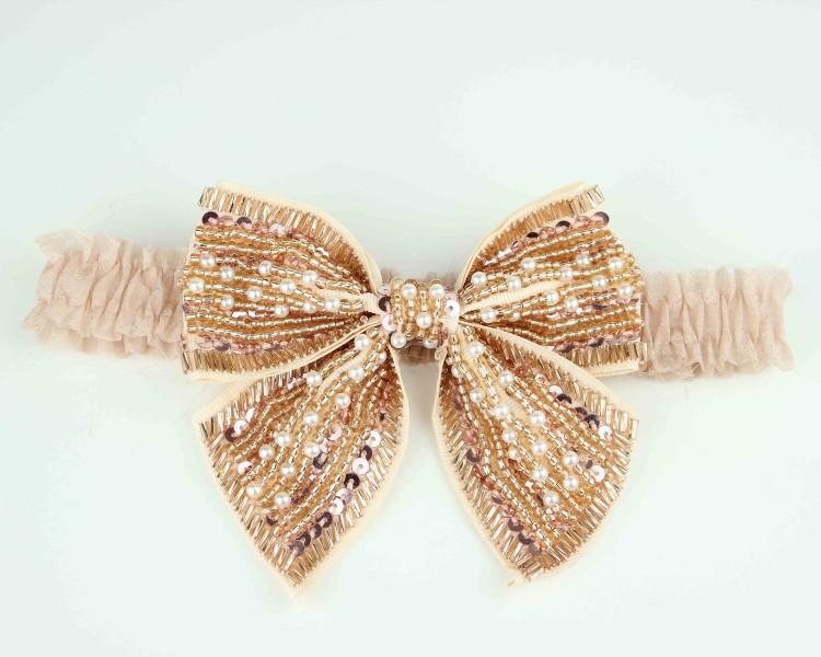 gold-beaded-bridal-garter-bows-2012-wedding-trend.original