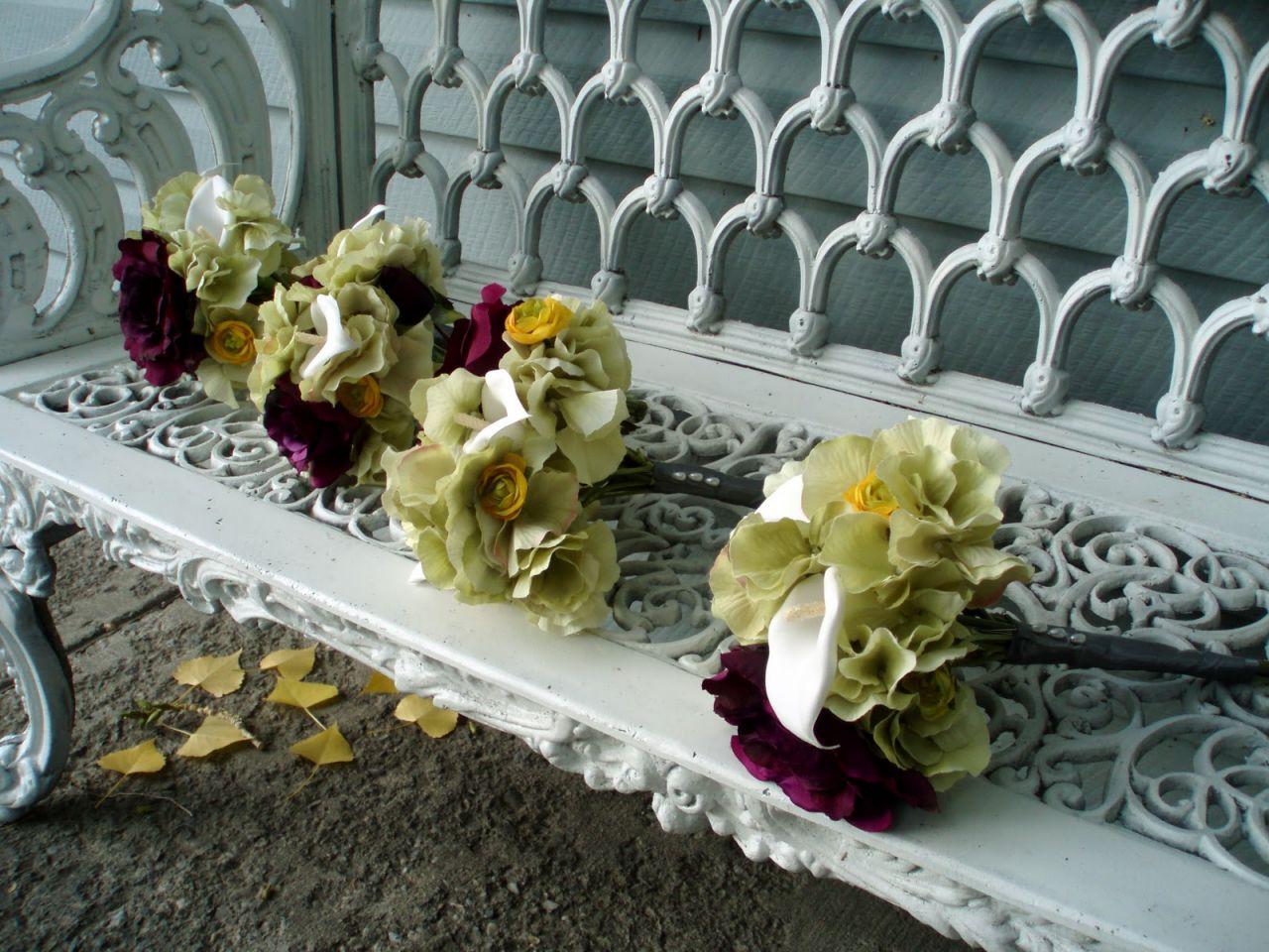 the-bridesmaid-bouquets-green-hydrangea-with-dark-purple-roses-55f3940454f23